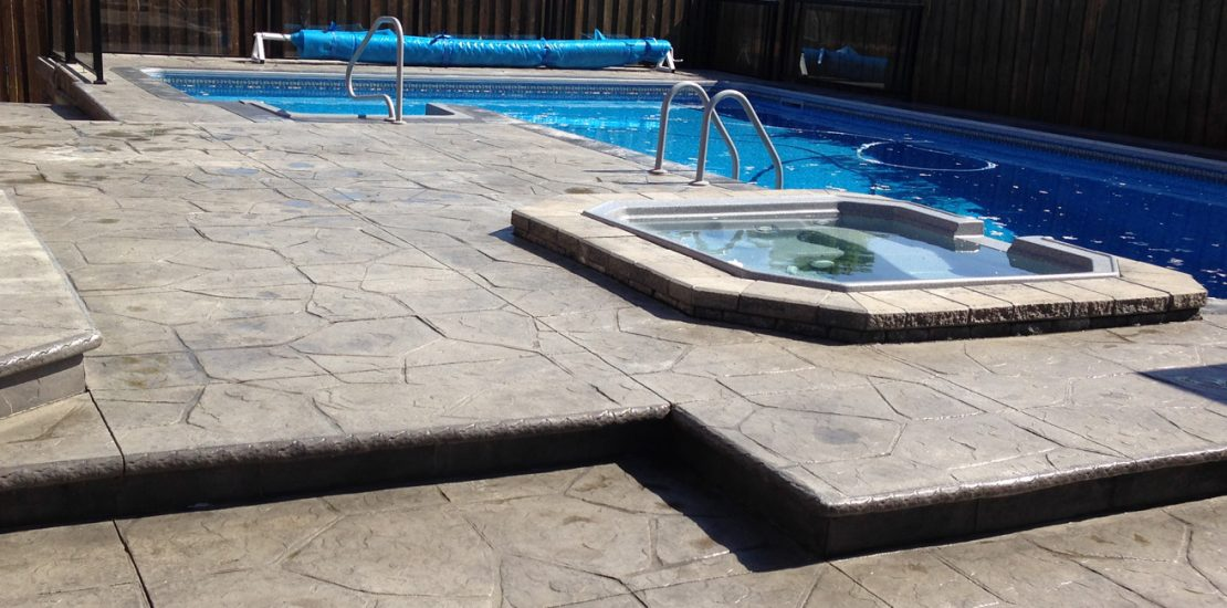Stamped concrete around a swimming pool
